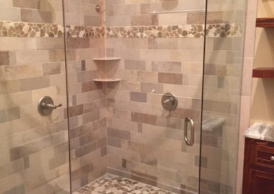 Custom corner shower glass installed in Traverse City, MI by Twin Bay Glass