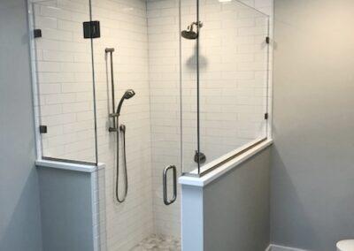 Half wall shower door with return